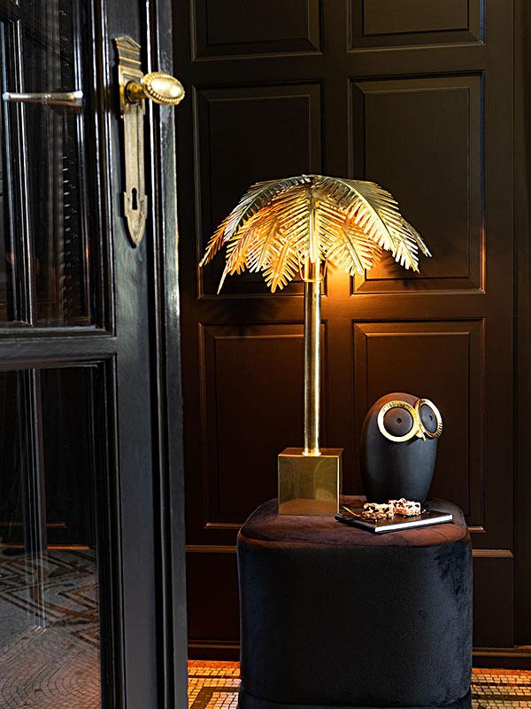 Ambiance lampe de table FEUILLES DE COCO ACIER OR (ALLUMÉE)_96492 (1) jolipa